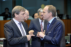 Jeannot  Krecke, Luxembourg's minister of economy and foreign trade, left, speaks with Luc Frieden, Luxembourg's minister of Finance, right, during ECOFIN, the meeting of EU finance ministers, at the European Council headquarters in Brussels, Belgium, on Tuesday, Nov. 10, 2009. (Photo © Jock Fistick)
