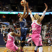 Maya Moore, (centre), Minnesota Lynx, shoots over Katie Douglas, (right), and Renee Montgomery, Connecticut Sun, during the Connecticut Sun Vs Minnesota Lynx, WNBA regular season game at Mohegan Sun Arena, Uncasville, Connecticut, USA. 27th July 2014. Photo Tim Clayton
