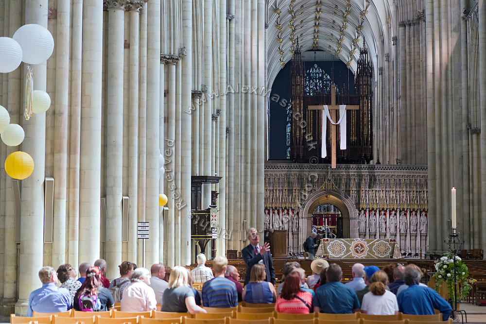 Tourists are attending a guided tour of York Minster, Yorkshire, England, United Kingdom.