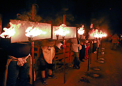 13 Feb 2015. New Orleans, Louisiana.<br /> Mardi Gras. Krewe D'Etat prepares to make its way along Magazine Street. Lining up with the flambeaux walkers as they prepare for the parade.<br /> Photo; Charlie Varley/varleypix.com