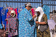 Tashkent, Uzbekistan, 12/05/2004..Women selling tradition clothes at Chorsu [Chor Su] market, in central Tashkent.