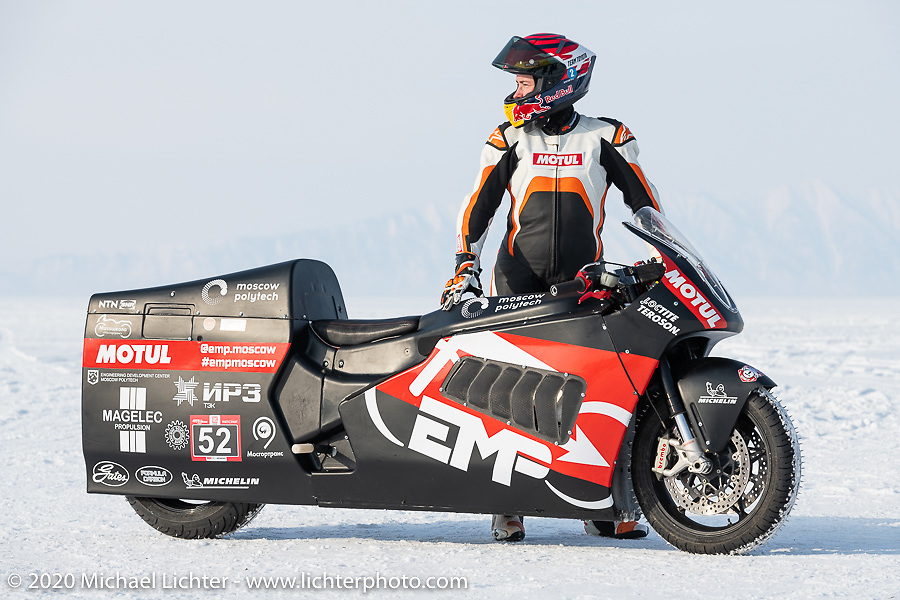 Mikhail Mikhin with the Moscow Polytechnic University electric motorcycle racer he piloted and that they built for the Baikal Mile Ice Speed Festival. Maksimiha, Siberia, Russia. Saturday, February 29, 2020. Photography ©2020 Michael Lichter.