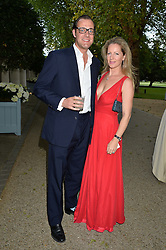 MAX KONIG and JULIET FETHERSTONHAUGH at a dinner hosted by Cartier in celebration of The Chelsea Flower Show held at The Hurligham Club, London on 19th May 2014.