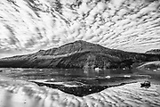 Black and white arctic landscape of the east coast of Greenland and a tourist ship,Scoresby Sound, East Greenland