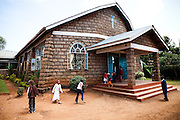 NAIROBI, KENYA – MARCH 14, 2010: African children play outside of a church before the service.