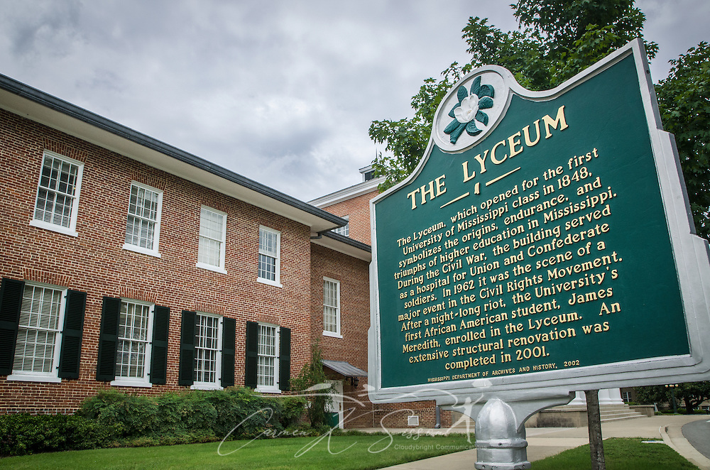 A historic marker stands in front of the Lyceum on the University of Mississippi campus, July 30, 2013, in Oxford, Miss. The building was the site of riots in 1962 following the enrollment of James Meredith, the first black student on campus. Last fall, around 40 students created a disturbance when they gathered in front of the building to protest the re-election of President Barack Obama. After the incident, university officials formed an ad hoc committee to re-examine race relations on campus. (Photo by Carmen K. Sisson/Cloudybright)