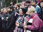 Football fans celebrate as Dulwich Hamlet FC beat Eastbourne Borough 2 - 1 during their first home game at Champion Hill on 26th December 2018 in South London in the United Kingdom. The National League South team return to their home ground, Champion Hill following a 10 month eviction initiated by the clubs landlord, Meadow Residential. During the exile, local team Tooting and Mitcham United offered a groundshare at Imperial Fields.
