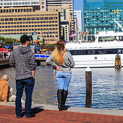 Baltimore, MD / US - October 15, 2016: Visitors enjoy the view at the city's Inner Harbor waterfront.