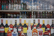 A detail of an off-licences window showing bottles of wines and spirits, in south London, on 6th October 2016, in London, England.