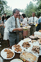 August 1976, Plains, Georgia, USA --- Jimmy Carter gets a helping of fried chicken and brownies at a family reunion just after he was nominated for ic presidential candidate. --- Image by © Owen Franken/CORBIS