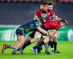 Jack O'Donoghue of Munster  under pressure from Scott Otten of Ospreys<br /> <br /> Photographer Simon King/Replay Images<br /> <br /> European Rugby Champions Cup Round 1 - Ospreys v Munster - Saturday 16th November 2019 - Liberty Stadium - Swansea<br /> <br /> World Copyright © Replay Images . All rights reserved. info@replayimages.co.uk - http://replayimages.co.uk