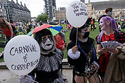 Carnival of corruption balloon protesters at Extinction Rebellion demonstration on 3rd September 2020 in London, United Kingdom. With government resitting after summer recess, the climate action group has organised two weeks of events, protest and disruption across the capital. Extinction Rebellion is a climate change group started in 2018 and has gained a huge following of people committed to peaceful protests. These protests are highlighting that the government is not doing enough to avoid catastrophic climate change and to demand the government take radical action to save the planet.