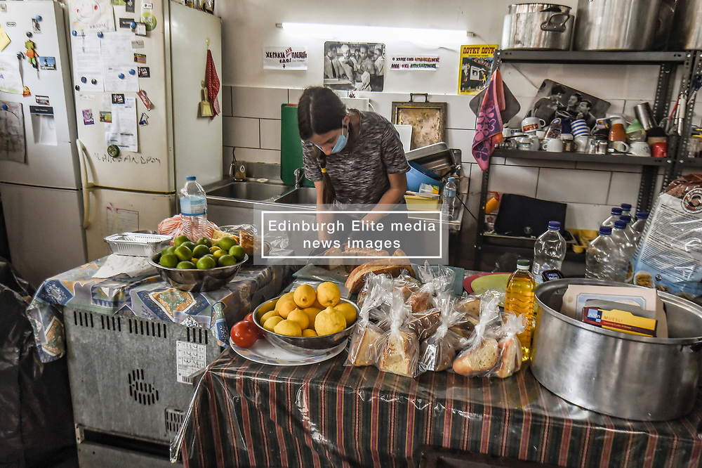 Volunteers prepare packages with daily meal to be distributed to people in need on the premises of the social kitchen 'The Other Human' in Athens on 15 April 2020. - The social kitchen appeared in the middle of the Greek financial crisis, adapting now during the COVID-19 pandemic and confinement, distibuting meals to unemployed, migrants, homeless and eldery people.<br />