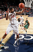 CHARLOTTESVILLE, VA- NOVEMBER 26:  Mike Scott #23 of the Virginia Cavaliers grabs a rebound during the game on November 26, 2011 at the John Paul Jones Arena in Charlottesville, Virginia. Virginia defeated Green Bay 68-42. (Photo by Andrew Shurtleff/Getty Images) *** Local Caption *** Mike Scott