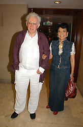 MR JON HALLIDAY and writer JUNG CHANG at a party to celebrate the publication of Diana by Sarah Bradford held at 80 The Strand, London on 27th September 2006.<br />