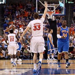 Mar 19, 2011; Tampa, FL, USA; Florida Gators forward Erik Murphy (33) reacts after hitting a three point basket against the UCLA Bruins during second half of the third round of the 2011 NCAA men's basketball tournament at the St. Pete Times Forum. Florida defeated UCLA 73-65.  Mandatory Credit: Derick E. Hingle