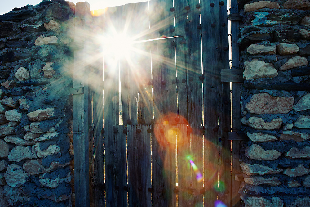 Sunlight shining through a fence in the Tabernas desert (Almeria, Spain).<br /> <br /> + ART PRINTS +<br /> To order prints or cards of this image, visit:<br /> http://greg-stechishin.artistwebsites.com/featured/hope-greg-stechishin.html