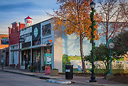 """Main Street and water tower in Frisco, Texas. Frisco is a city in Collin and Denton counties in Texas. It is part of the Dallas-Fort Worth metroplex, and is approximately 25 miles from both Dallas Love Field and Dallas/Fort Worth International Airport. Since 2003, Frisco has received the designation """"Tree City USA"""" by the National Arbor Day Foundation. When the Dallas area was being settled by American pioneers, many of the settlers traveled by wagon trains along the old Shawnee Trail. This trail was also used for cattle drives north from Austin. This trail later became the Preston Trail, and later, Preston Road. Preston Road is one of the oldest north-south roads in all of Texas. With all of this activity, the community of Lebanon was founded along this trail and granted a U.S. post office in 1860. In 1902, a line of the St. Louis-San Francisco Railway was being built through the area, and periodic watering stops were needed along the route for the steam locomotives. The current settlement of Lebanon was on the Preston Ridge and was thus too high in elevation, so the watering stop was placed about four miles (6 km) to the west on lower ground. A community grew around this train stop. Residents of Lebanon actually moved their houses to the new community on logs. The new town was originally named Emerson, but the U.S. Postal Service rejected the name as being too similar to another town in Texas. In 1904, the residents chose Frisco City in honor of the St. Louis–San Francisco Railway on which the town was founded, later shortened to its present name."""