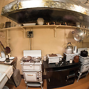 The kitchen at the Churchill War Rooms in London. The museum, one of five branches of the Imerial War Museums, preserves the World War II underground command bunker used by British Prime Minister Winston Churchill. Its cramped quarters were constructed from a converting a storage basement in the Treasury Building in Whitehall, London. Being underground, and under an unusually sturdy building, the Cabinet War Rooms were afforded some protection from the bombs falling above during the Blitz.