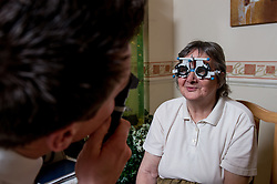 Optician visiting a residential home for the elderly UK