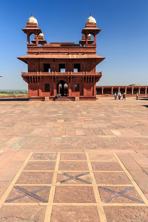"""Pachisi Court in Fatehpur-Sikri, India. Pachisi was a common gambling sport at the court of the Mughal emperor Akbar in Agra and Fatehpur Sikri. The emperor himself was an addict and in the courtyard of his palace at Fatehpur Sikri he had laid out in flagstones a huge """"board"""" where he and his courtiers enjoyed the game, using slave girls as the playing pieces."""