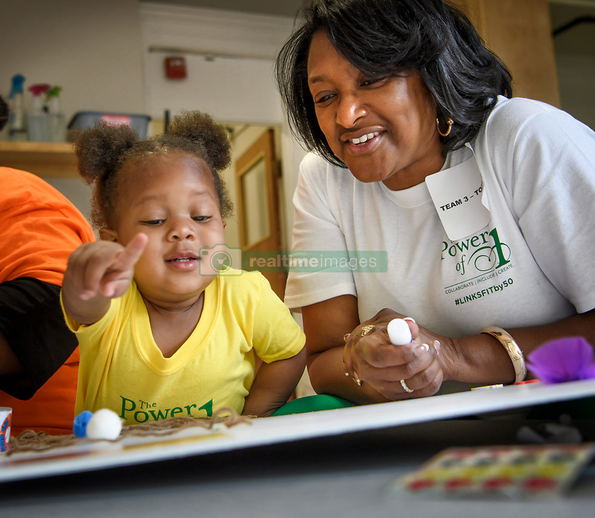 June 7, 2017 - Minneapolis, Minnesota, USA - Links volunteer Karen Patricia Williams, right, used glue, stickers, feathers and magazine photos to help Tamijai Long construct a Mood Board to show what is special about her, in her mind, her heart and in her tummy at Agape Childhood Development Center.  ..       ] GLEN STUBBE Â¥ glen.stubbe@startribune.com Tuesday June 6, 2017  800 African American women descend on the Twin Cities for service projects.   100 Links members worked on a service project at Agape Childhood Development Center in North Minneapolis. (Credit Image: © Glen Stubbe/Minneapolis Star Tribune via ZUMA Wire)