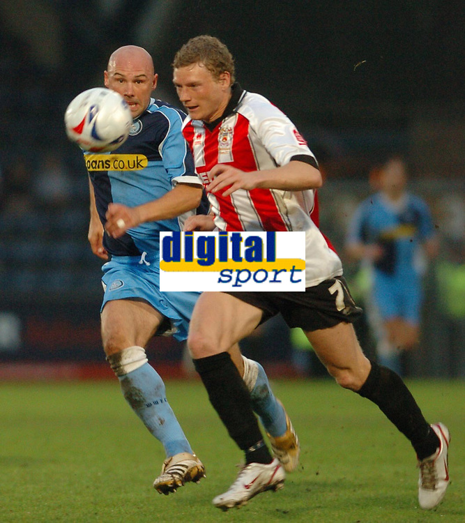 Photo: Leigh Quinnell.<br /> Wycombe Wanderers v Cheltenham Town. Coca Cola League 2, Play off Semi Final. 13/05/2006. Wycombes Tommy Mooney keeps an eye on Cheltenhams Brian Wilson.