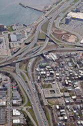 """Pearl Harbor Memorial """"Q"""" Bridge, East Bound Approaches just west of Bridge. I95 I91 Route 34 Interchange Aerial Photograph, view Southwest, I-91 bottom left vertical. Showing surface Streets: Chapel, Hamilton, Water, East & Wooster and Long Wharf Drive on 17 April 2009."""