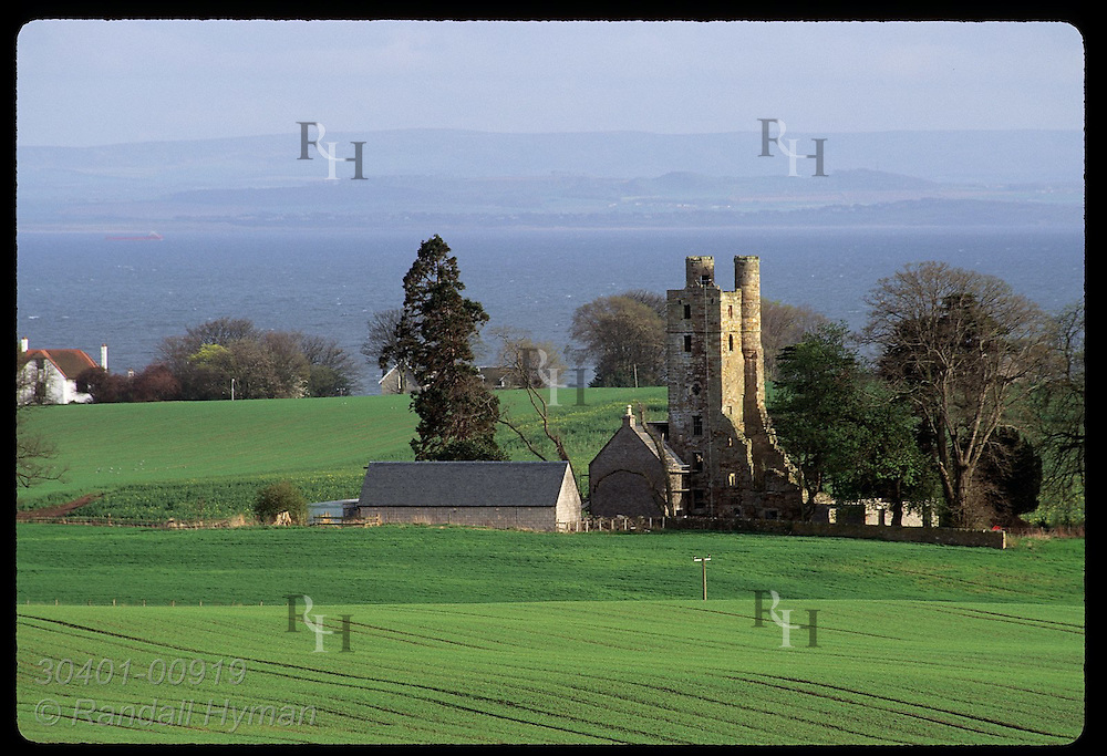 Ruins of Pilmuir sit amid green fields in late afternoon light of April; East Neuk of Fife. Scotland