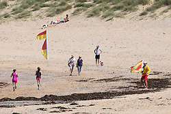 © Licensed to London News Pictures. 29/05/2020. Padstow, UK. RNLI Lifeguards resume service on Constantine beach on the north coast of Cornwall this morning, as one of a select few beaches. Up until today, the RNLI have not been providing a lifeguard service in Cornwall, due to Coronavirus (COVID-19). The weather in the south-west is forecast to be warm over the weekend, with highs of 23 degrees Celsius. Photo credit : Tom Nicholson/LNP