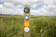 Route markers for Angles Way long distance footpath in marshes near Oulton Broad, Suffolk, England