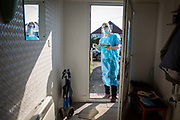 As part of a home visiting service for housebound patients Dr Fordham of the Channel Health Alliance dressed in the appropriate PPE attends a patient at their home in the community outside Dover to administer the COVID-19 Vaccination on the 27th of February 2021, Dover, Kent, United Kingdom.