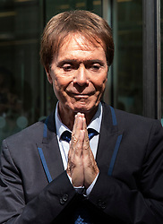© Licensed to London News Pictures. 18/07/2018. London, UK. SIR CLIFF RICHARD holds his hands together in prayer as he leaves the Rolls Building of the High Court in London after winning his claim for damages against the BBC for loss of earnings. The 77-year-old singer sued the corporation after his home in Sunningdale, Berkshire was raided following allegations of sexual assault made to Metropolitan Police. Photo credit: Rob Pinney/LNP