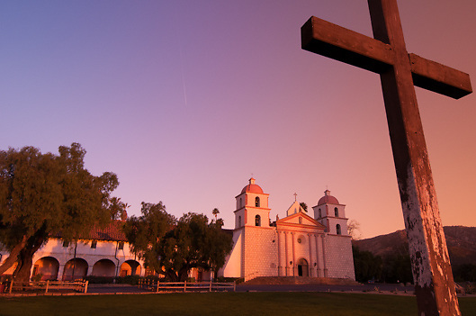 Wooden cross stands in front of historic Santa Barbara Mission on Cenral Coast of California USA