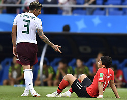 ROSTOV-ON-DON, June 23, 2018  Carlos Salcedo (L) of Mexico reacts with Hwang Heechan of South Korea after the 2018 FIFA World Cup Group F match between South Korea and Mexico in Rostov-on-Don, Russia, June 23, 2018. Mexico won 2-1. (Credit Image: © Chen Yichen/Xinhua via ZUMA Wire)