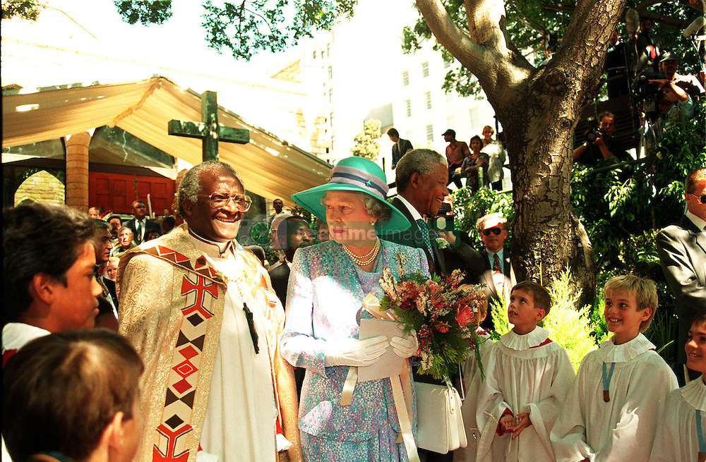 Queen Elizabeth talks with Archbishop Desmond Tutu as she and President Nelson Mandela leave St George's Cathedral in Cape Town, after attending a service to mark human rights day.