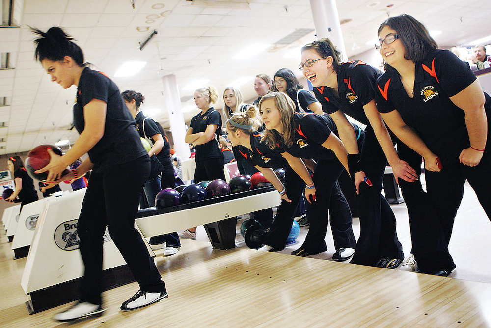 "Ashlen Ayers, 17, prepares to bowl in a baker during a match against Wenatchee at home while teammates Charlotte Johnson, 17, right, Dayna Bolt, 17, Karissa Shiflet, 16, and Brittany Blackketter, 17, show their support with a ""power stance"" that Ashlen's dad Lenny passed along to Ashlen from his baseball and football days. During the baker rounds, the team rotates through each bowler frame by frame."