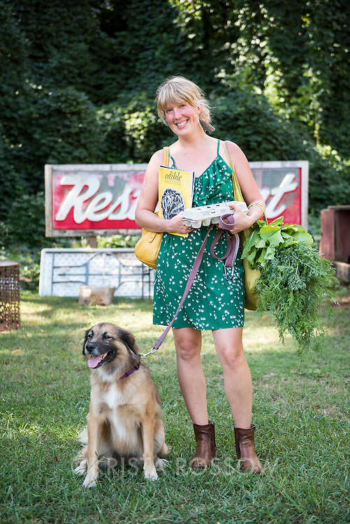 Local Rebecca Anderson (model released) poses with her dog Birdie at the RAD Farmers Market. The weekly River Arts District Farmers Market is held Wednesdays at 175 Clingman Avenue (next to All Souls Pizza) in the River Arts District of Asheville, North Carolina.