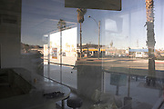 looking through a window of an empty diner with reflection Palm Springs USA