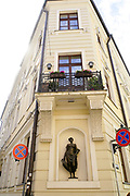 Statue of topless woman on a building on the corner of Pils and Miesnieku streets, Riga, Latvia