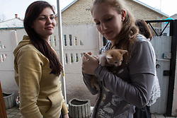 Elena, 17, (l) and Diana, 17, (r) with kitten. Elena, a resident of Lugansk Orphanage No.1 since the age of three, has received the kitten as a present from her boyfriend Sergey, 22.