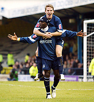 Photo: Chris Ratcliffe.<br />Southend United v Brentford. Coca Cola League 1. 14/01/2006.<br />Efe Sodje is straddled by Mark Gower after opening the scoring for Southend.