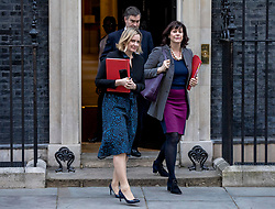 """© Licensed to London News Pictures. 26/02/2019. London, UK. Secretary of State for Work and Pensions Amber Rudd (L), Justice Secretary David Gauke (C) and Minister of State at Department for Business, Energy and Industrial Strategy Claire Perry (R) leave 10 Downing Street after the Cabinet meeting. All three ministers have suggested that they would consider resigning from government in order to vote against the possibility of a """"no deal"""" Brexit. Photo credit: Rob Pinney/LNP"""