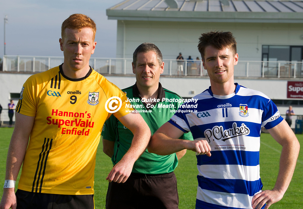 15-08-20. Navan O'Mahony's v Na Fianna - Meath SFC - Group B - Round 2 at St. Loman's Park, Trim.<br /> Na Fianna captain Daniel Queeney and Navan O'Mahony's captain Ruairi O'Coileain observe Covid 19 guidelines to the letter with the pre match handshake while referee Bernard Heaney stays 2 metres back.<br /> Photo: John Quirke / www.quirke.ie<br /> ©John Quirke Photography, 16 Proudstown Road, Navan. Co. Meath. (info@quirke.ie / 046-9028461 / 087-2579454).
