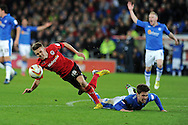 Cardiff city's Craig Noone is fouled by Peterborough's Tommy Rowe. NPower championship, Cardiff city v Peterborough Utd at the Cardiff city stadium in Cardiff, South Wales on Sat 15th Dec 2012. pic by Andrew Orchard, Andrew Orchard sports photography,