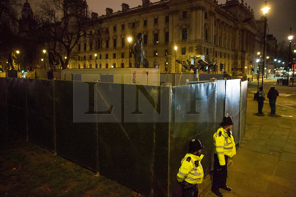 © Licensed to London News Pictures.31/12/2020, London, UK. A barrier is erected around Parliament Square, central London as New Year celebration was prohibited as three quarters of England plunged into Tier 4 last night. This New Year's Eve Londoners need to stay at home according to Tier 4 guidelines. Photo credit: Marcin Nowak/LNP