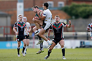 Keighley Cougars interchange Joshua Lynam (11) is penalised for tackling York City Knights winger Keiron Moss (28) in the air during the Betfred League 1 match between York City Knights and Keighley Cougars at Bootham Crescent, York, England on 25 March 2018. Picture by Simon Davies.