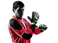one  soccer player goalkeeper man adjusting gloves in silhouette isolated white background
