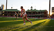 Dane Rampe of the Swans kicks during the 2014 AFL Round 13 match between the Sydney Swans and Port Adelaide Power at the SCG, Sydney on June 14, 2014. (Photo: Craig Golding/AFL Media)