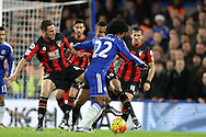 Willian of Chelsea is tackled by Dan Gosling of Bournemouth and Junior Stanislas of Bournemouth. Barclays Premier league match, Chelsea v AFC Bournemouth at Stamford Bridge in London on Saturday 5th December 2015.<br /> pic by John Patrick Fletcher, Andrew Orchard sports photography.